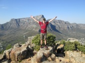 Top of Lion's Head, Table Mountain behind, Cape Town to left, Camps Bay on right