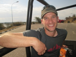 Happy to hitch in the back of a pickup after crossing the Batswana border!