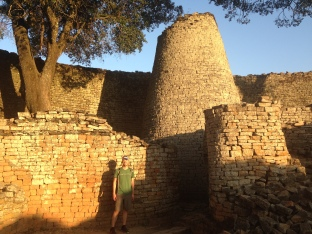Jon with tower at Great Zimbabwe - tower is a national symbol for Zimbabwe