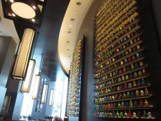 The lounge of our hotel lobby, floor to ceiling liquor bottles filled with decorative colored liquid