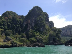 Limestone ridge and shore on boat ride from Ao Nang into Railay