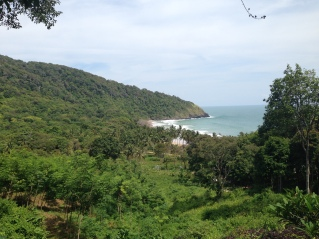 Lush green hills and beautiful small beach, Koh Lanta