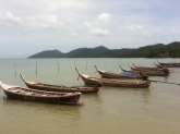 Long tail boats on another beach in Koh Yao Yoi