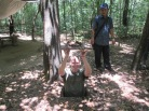 Jon trying out an entrance to the Chu Chi tunnels, with our awesome guide in the background