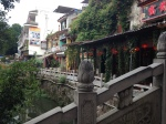 Shops and restaurants along the canal in downtown Yangshuo