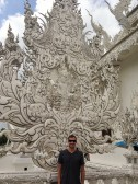 Posing with White Pagoda intricacies