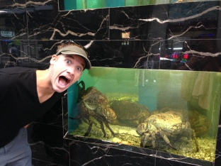 Jon afriad of the biggest crabs we've ever seen, outside a Sydney China town restaurant