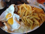 "Part 2 of 2 of our first traditional Chilean meal, recommended by our server - originally a ""sailor's dish"", fried eggs, steak, and onions over french fries"