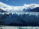 Perito Moreno glacier up close from viewing deck - giant calving happens all the time - iceburgs falling into the water - amazing to see in person