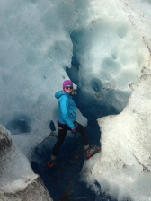 Jen in slot ice canyons within the glacier - amazing experience
