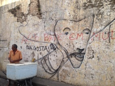 Olinda street art with Carnaval vendor