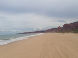 A couple miles down Gunga beach these cliffs appear. Jon walked. Brazilians ripped around on ATVs and dune buggies